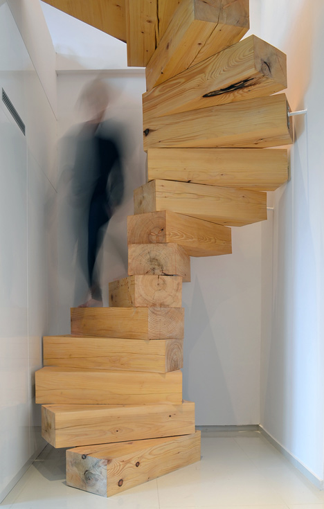 Spiral staircase made from chunky wooden blocks by QC