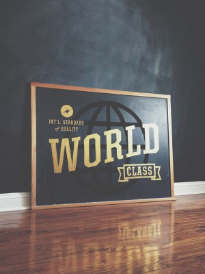 World Class. Int'l Standard of Quality.Hand painted on a vintage chalkboard.