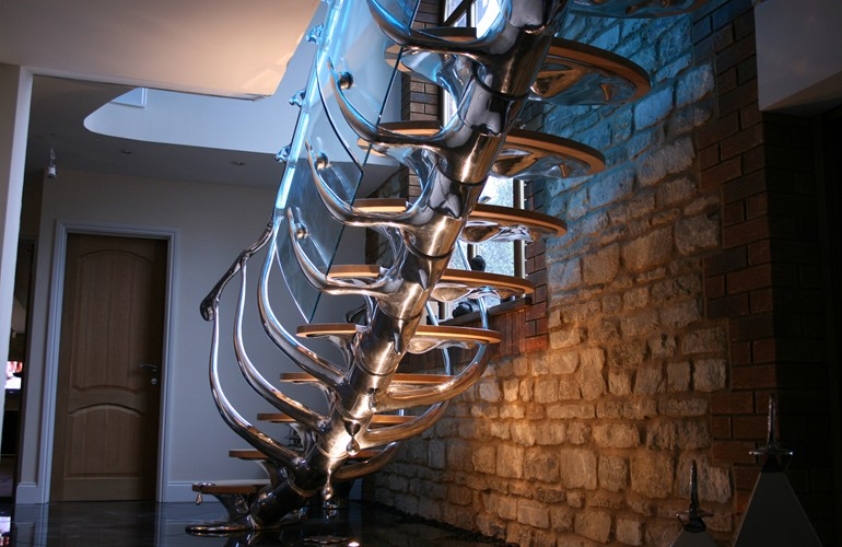 Sculptural staircase with glass and timber