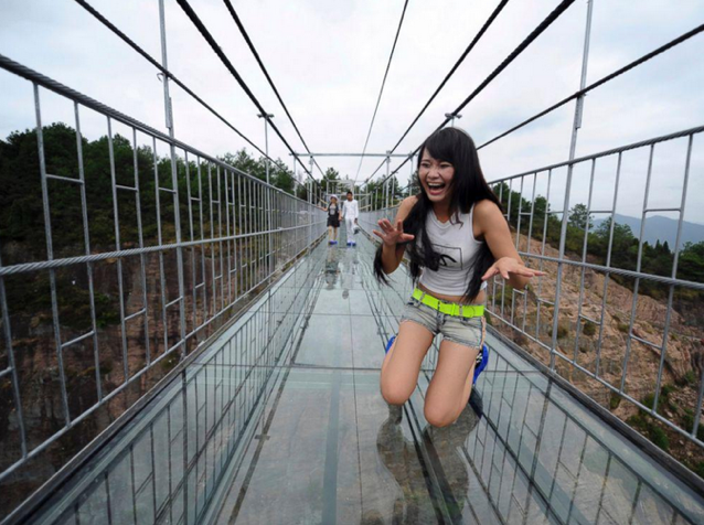 High-altitude suspension bridge made of glass opens in Hunan, China