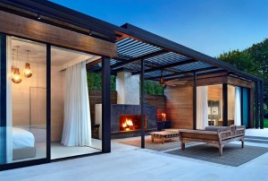 Lavish pool and spa retreat with a stunning wood and steel structure