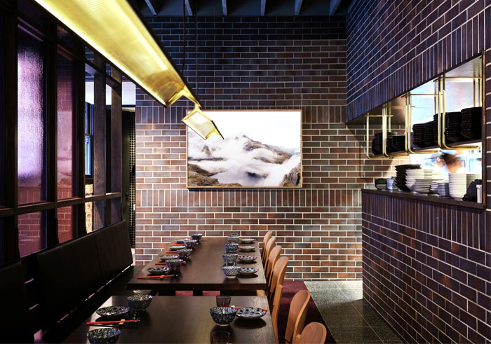 Restaurant With Artistic Facade Brick Wall and Graffiti – InteriorZine
