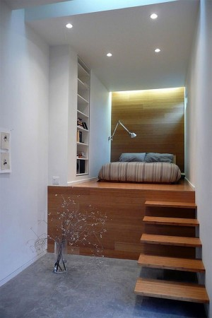 Small double room with bed elevated