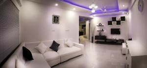 Sleek interior design in black & white, with purple lighting.