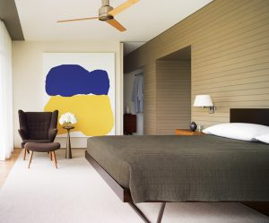 Neutral bedroom + colorful modern art: Interior design by Thad Hayes