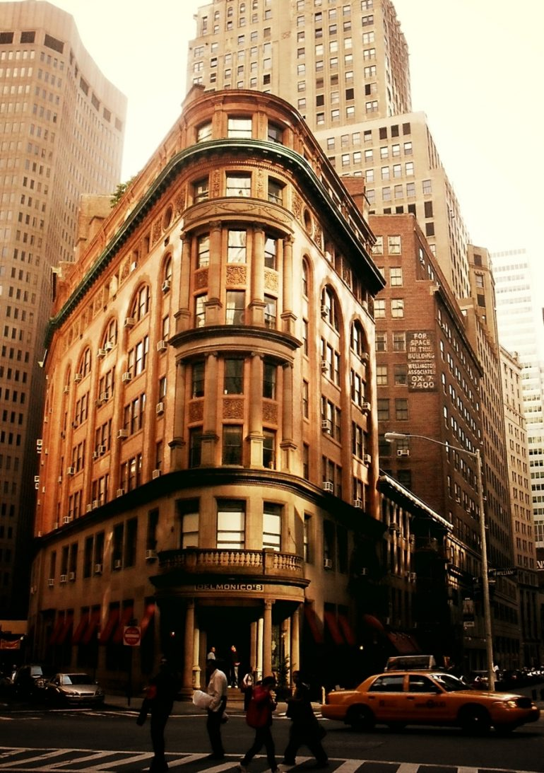Delmonico's in a sliver of sunlight. Financial District, New York City.