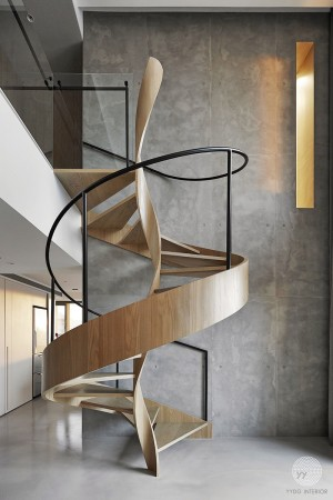 A Sculptural Spiral Staircase Makes A Statement In This Home's Interior