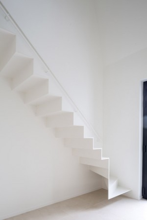Delicate staircase leads to attic extension by Five AM
