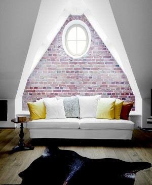 Howard White Sofa Against Decorative Brick Wall