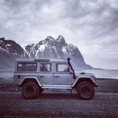 Land Rover on a remote beach