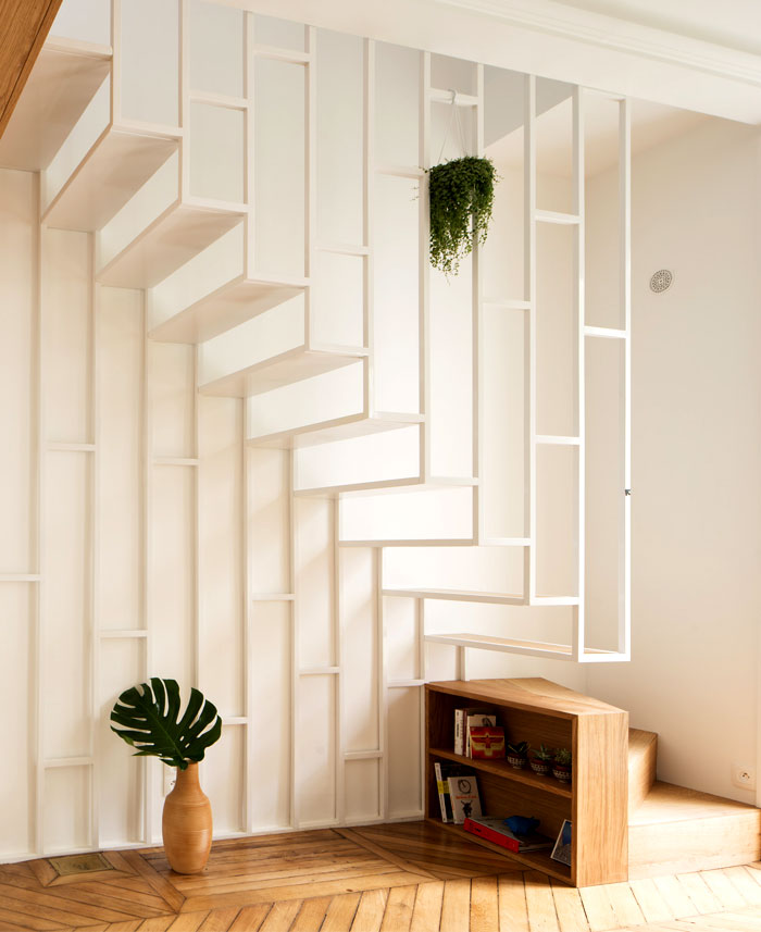 A staircase that connects internally the two floors – elegant and artistic structure that takes ...