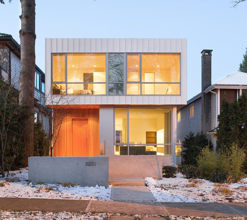 This new modern house in Vancouver is filled with light from the large windows facing the street