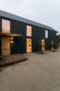 Alejandro Soffia slots two homes inside one long black building in Chile