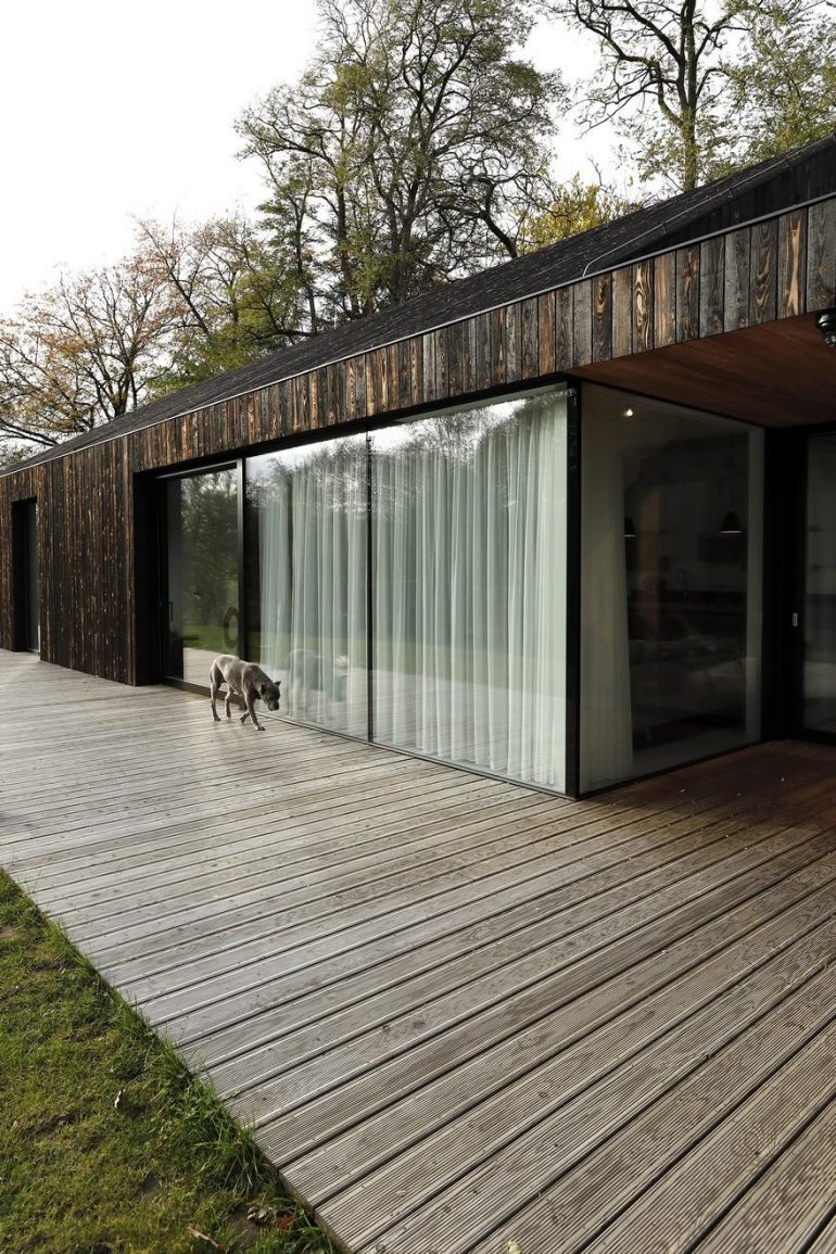 One-Story Family House Covered with Charred Larch Planks