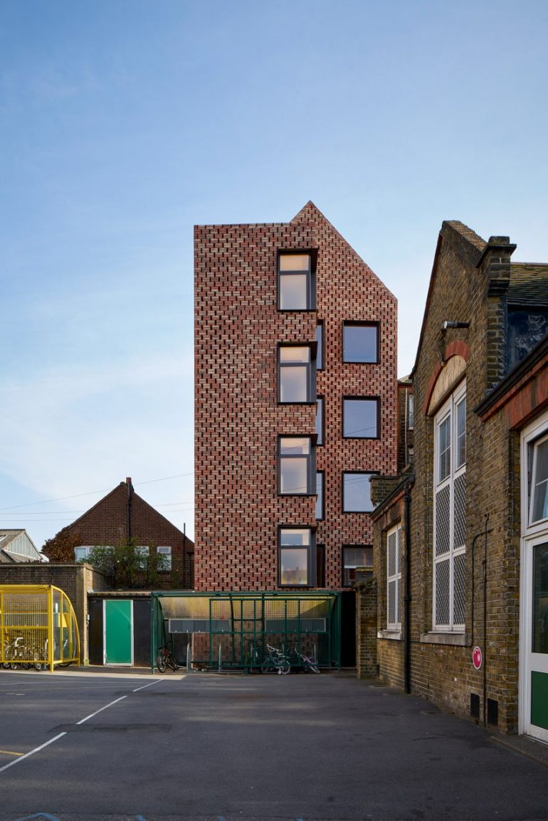 Slender apartment block by Amin Taha Architects has timber structure