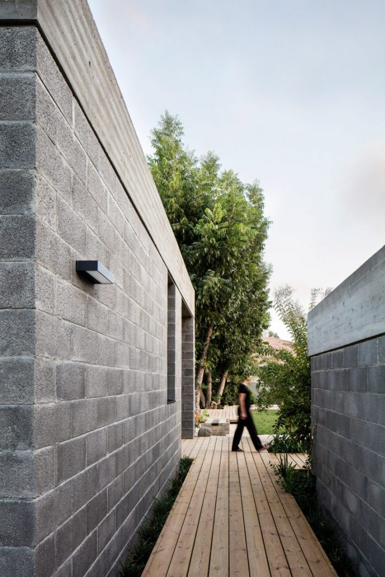 Israeli architect couple use concrete blocks to build themselves a home among fruit trees