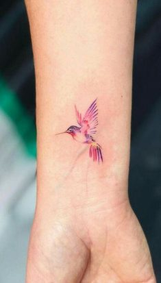 Hummingbird watercolor tattoo on wrist