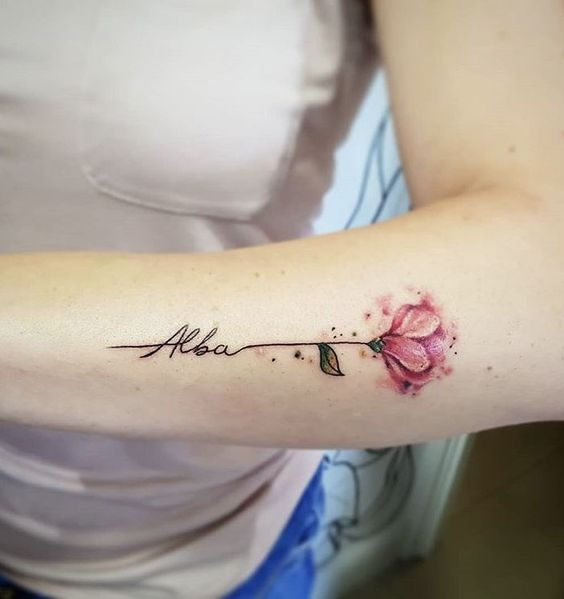 Flower with name tattoo for women