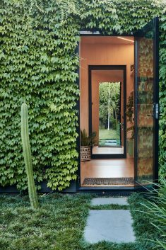 Writer's Shed by Matt Gibson is a Melbourne garden studio covered in ivy