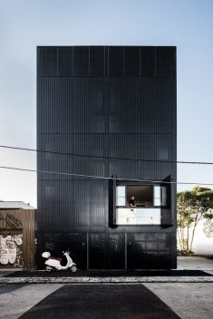 DKO + SLAB add black metal screen façade to vertical dwellings in australia