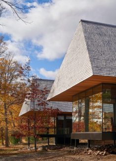 Massive hip roofs top Ontario cabins by MacKay-Lyons Sweetapple