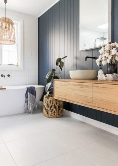 Room tour: A stunning deep blue, coastal luxe bathroom