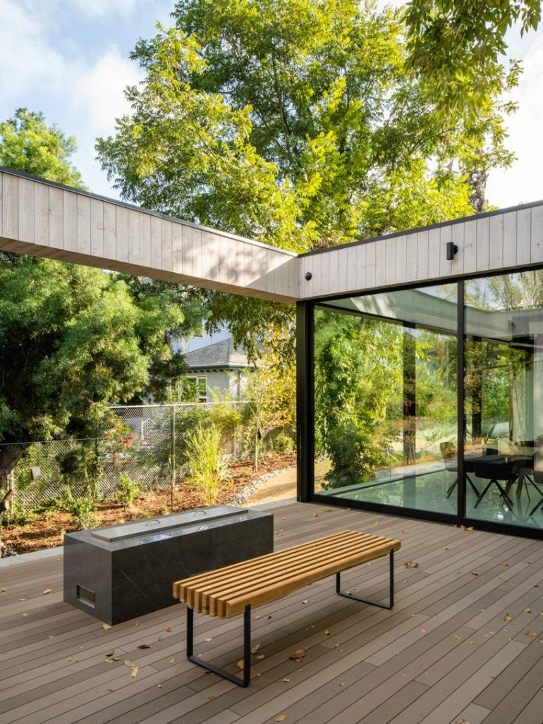 DBA's bridge house spans 60 meters over a natural stream in los angeles