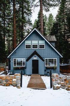 Blue and white cabin home in the winter snow of Tahoe.