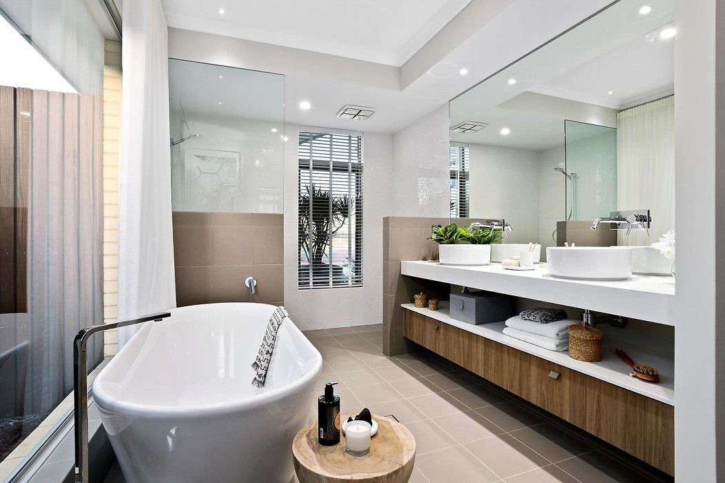 Half wall covered in same floor tile – nice way to end vanity / transition to shower & ...