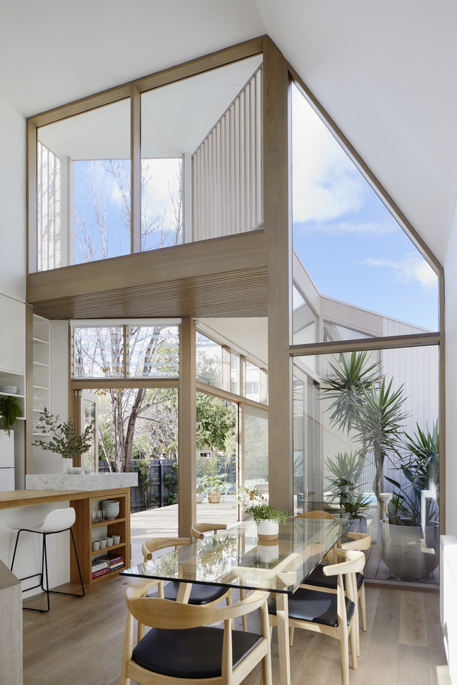 Unique way to bring in light in double height space – covering for clerestory window