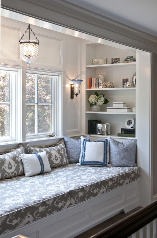 Great window seat nook with shelving