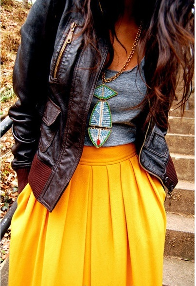 Attractive and stylish outfit, leather jacket, grey top and yellow long skirt