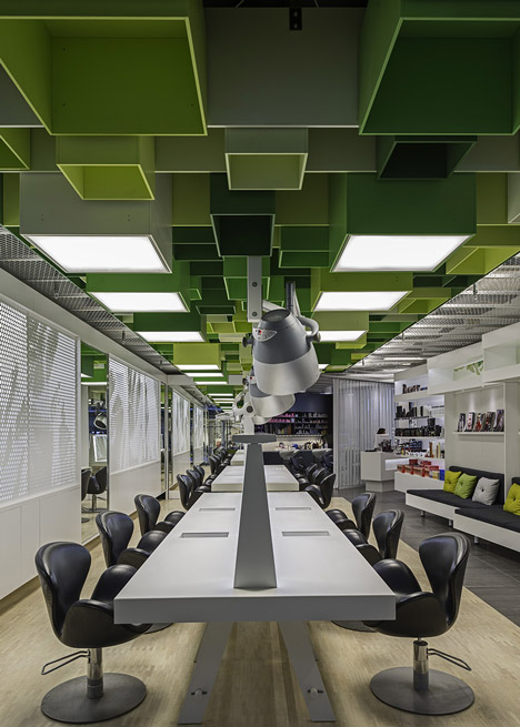 green boxes cover the ceiling of clip hair salon by sweco