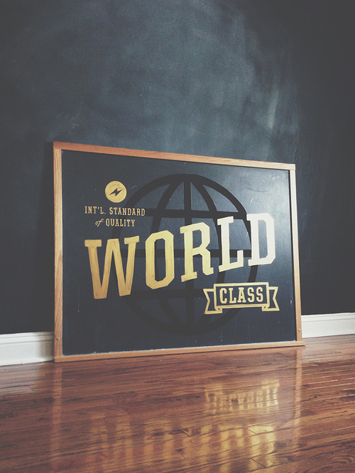 World Class. Int'l Standard of Quality. Hand painted on a vintage chalkboard.