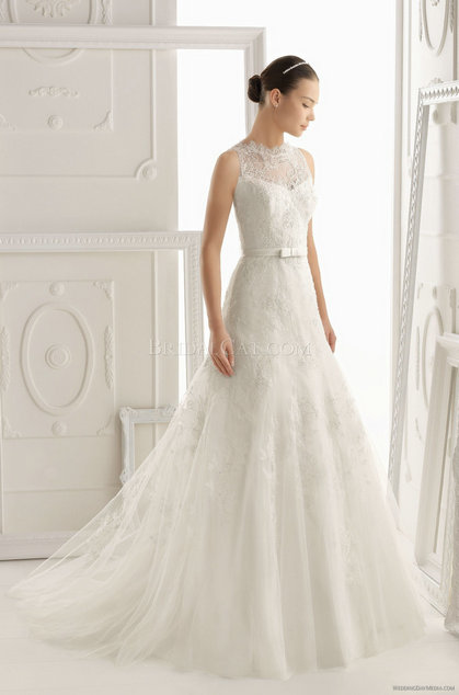 style 325.00 – Aire Barcelona 134 Oliv Wedding Gown,The back is open and has dramatic stra ...