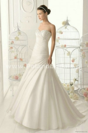 style 342.00 – Aire Barcelona 168 Orgullo Wedding Gown,Layers of organza develop the attra ...