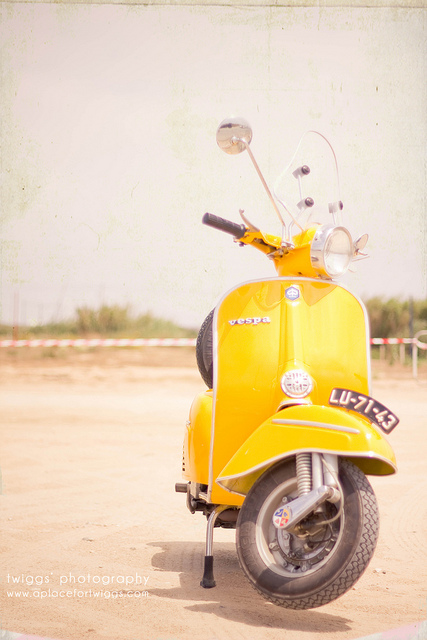 the {yellow} vespa by {Twiggs}