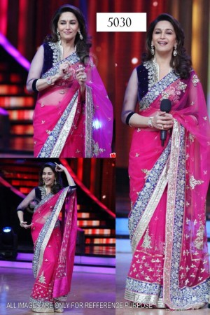 The forever young Star Madhuri Dixit wears a pink designer saree