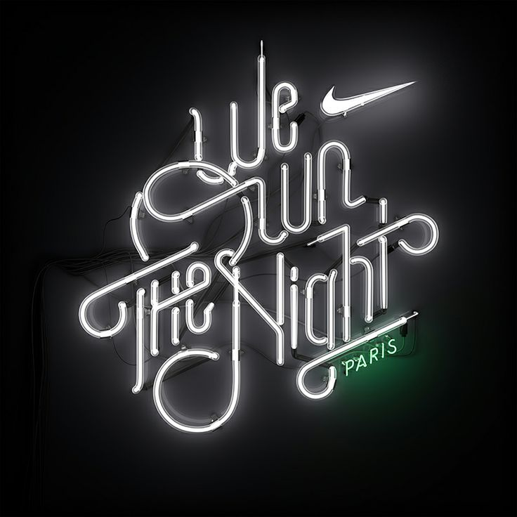 Neon signage for Nike's We Own The Night 10k Women's marathon.