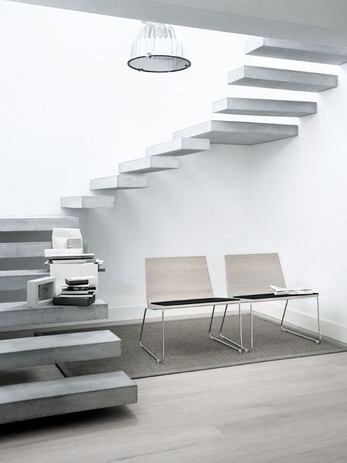 Spiral staircase with floating concrete steps.