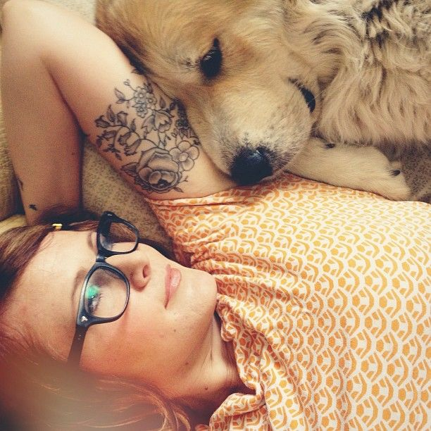 Floral tattoo… and cute snuggly dog