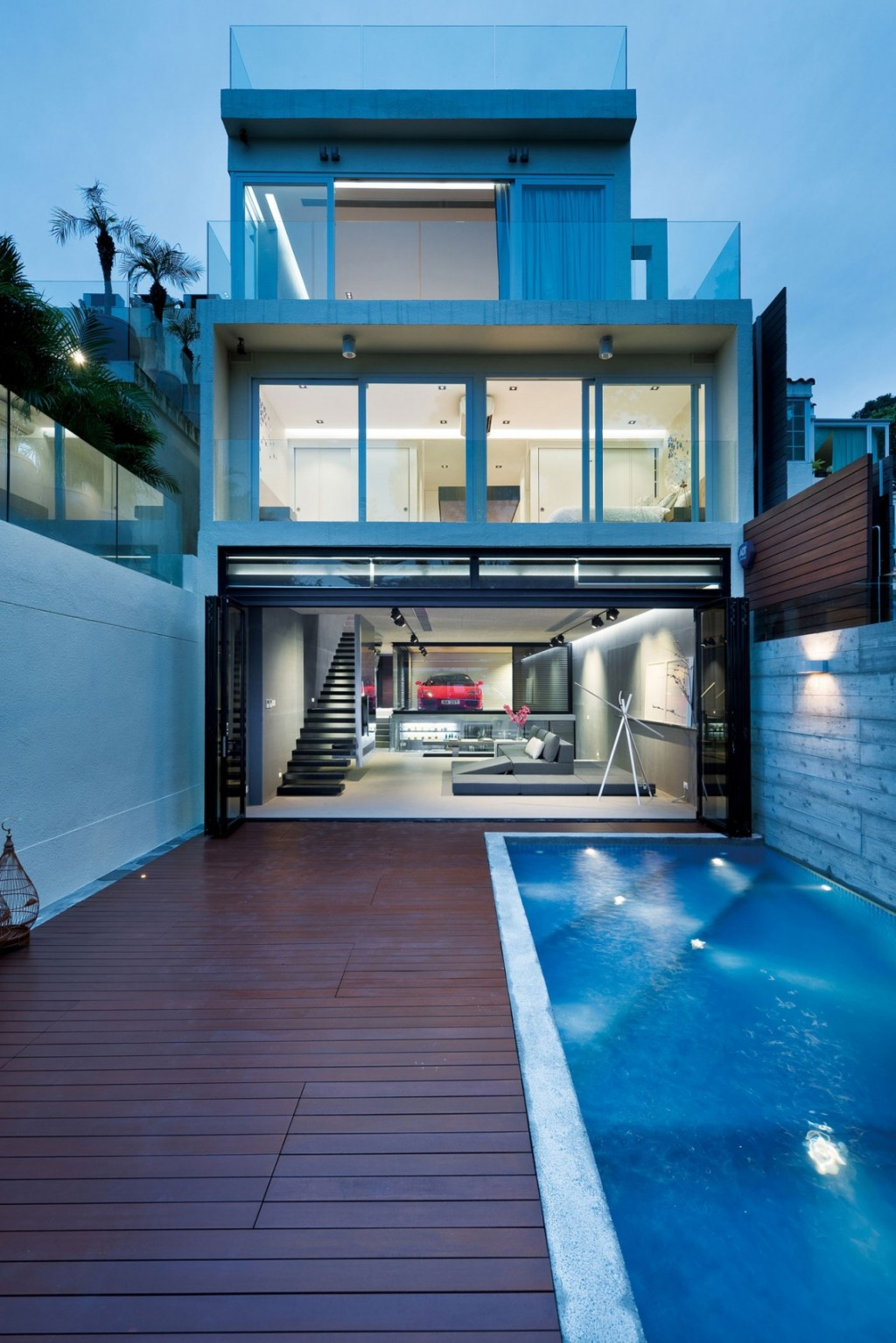 Split-Level Hong Kong Home Centered Around A Red Ferrari
