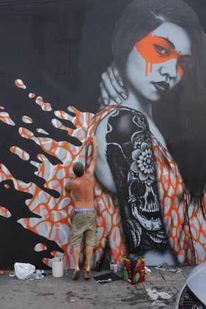 Beautiful Empowered Women Depicted in Orange Splashes of Paint