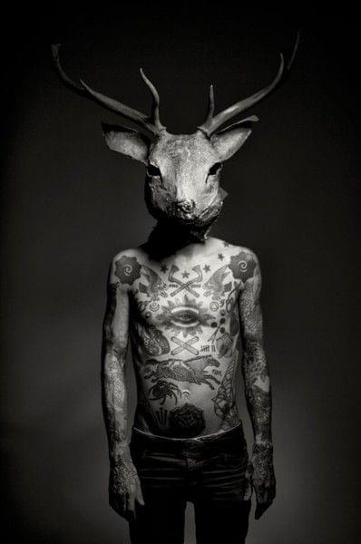 Full coverage tattoos. Deer head.