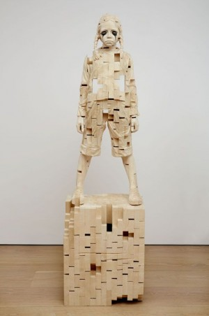Wooden sculptures of children created by Gerard Demetz