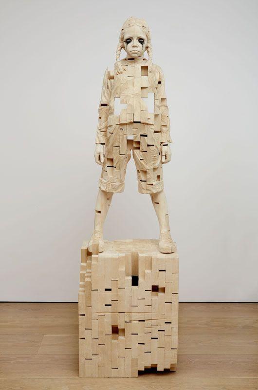 Wooden sculptures of children created by Gerard Demetz