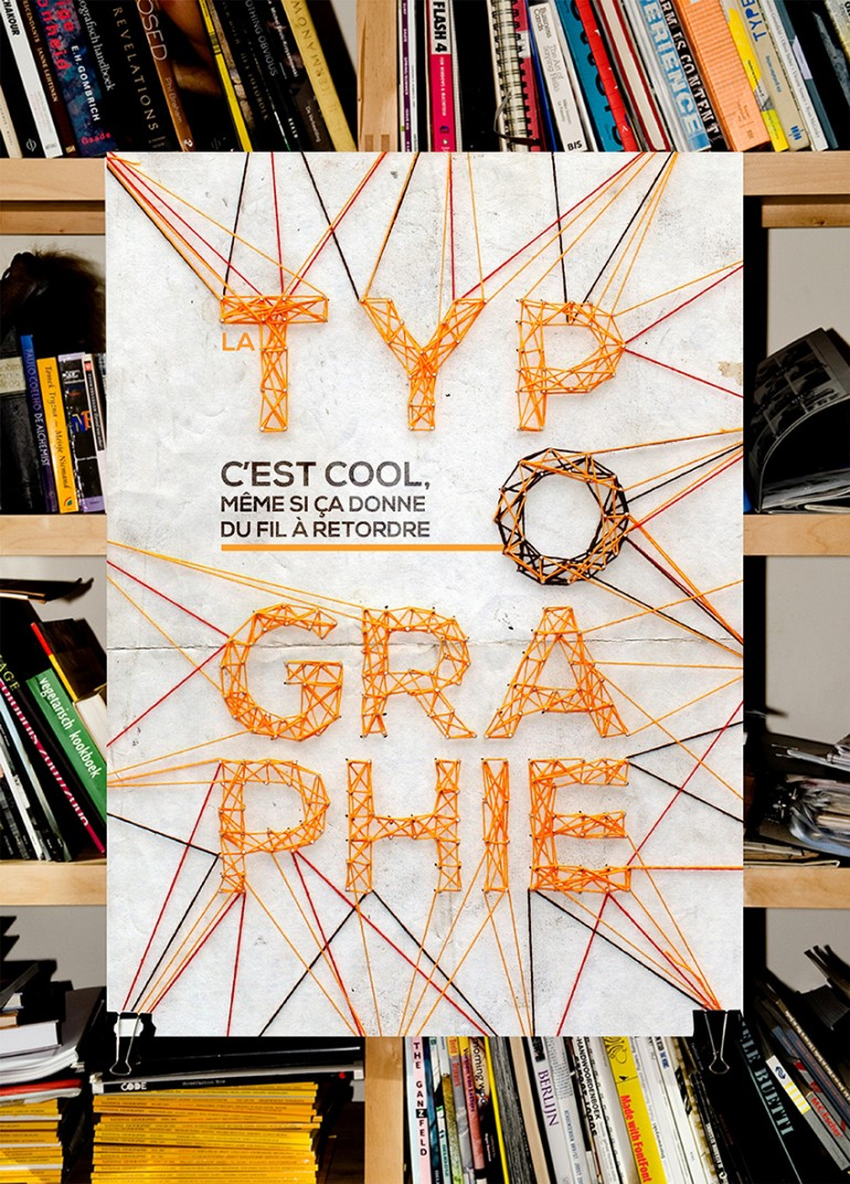"Production of a poster on ""Typography is …"". Made with wool and nails."