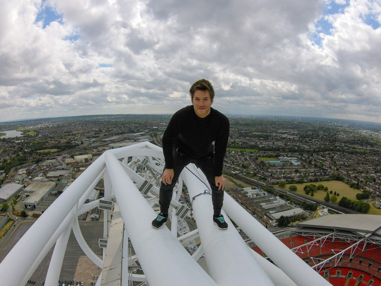 A daredevil just became the first person to scale the massive arch above Wembley Stadium