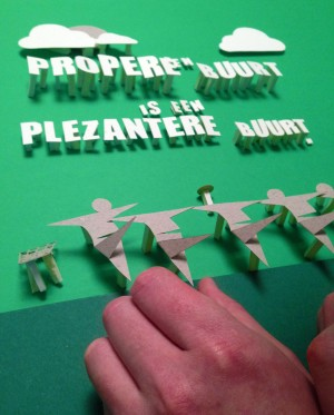 Behind the scenes of paper craft posters for a awareness campaign against littering.