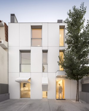 Hinged shutters camouflage with facade of townhouse by Humberto Conde